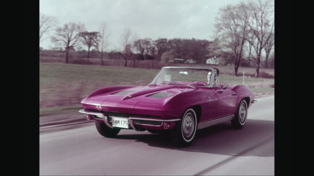 ws pov woman driving corvette car on country road and enjoying road trip / united states - collector's car stock videos and b-roll footage