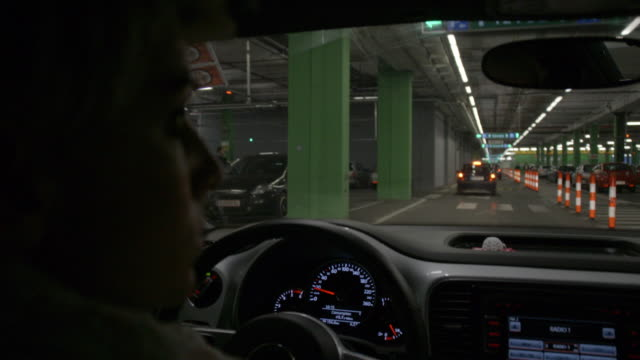 SLO MO Woman driving in a multi-storey car park