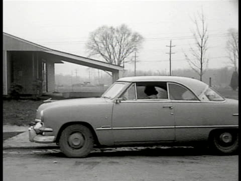 woman driving up to home in 1951 ford twodoor sedan woman w/ young girl dog walking to getting into car americana family car pool neighbor - levittown pennsylvania stock videos and b-roll footage