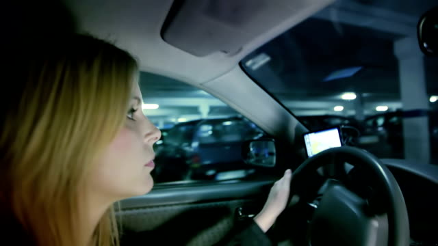 woman driving - parking stock videos & royalty-free footage