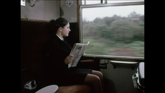 Woman driving, woman taking train