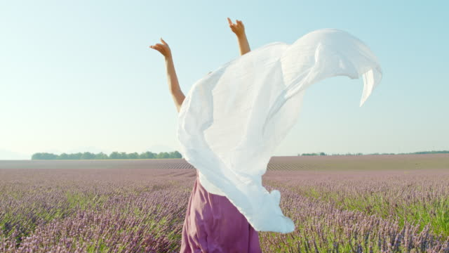 slo mo woman dropping a white scarf in lavender field - time warp effect - scarf stock videos & royalty-free footage