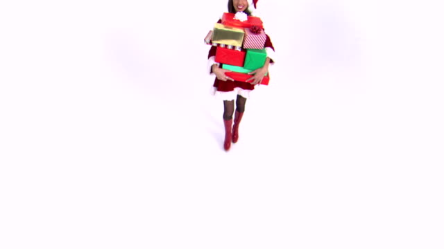 woman dropping stack of gifts - weihnachtsfrau stock-videos und b-roll-filmmaterial