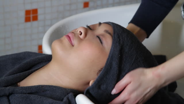 MS HA Woman drying hair from client in hair salon