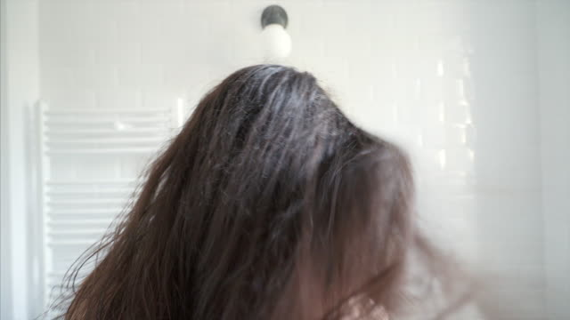 woman drying hair. - obscured face stock videos and b-roll footage