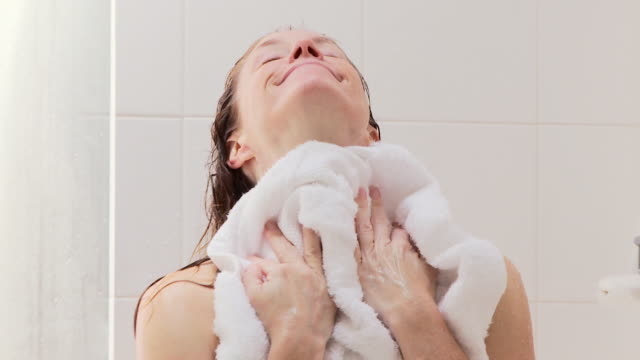 woman drying off after shower - towel stock videos & royalty-free footage