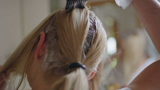 woman dyeing hair in the bathroom - dye stock videos & royalty-free footage