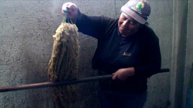 "woman dyeing wool with natural colors in salinas de guaranda, ""paramo"" (upland), ecuador - paramo stock videos and b-roll footage"