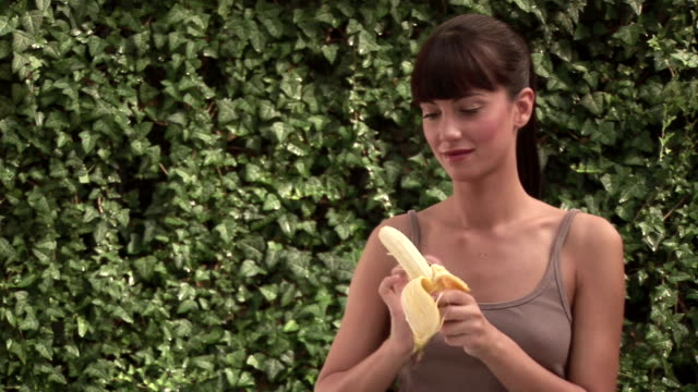 woman eating a banana - banana stock videos and b-roll footage