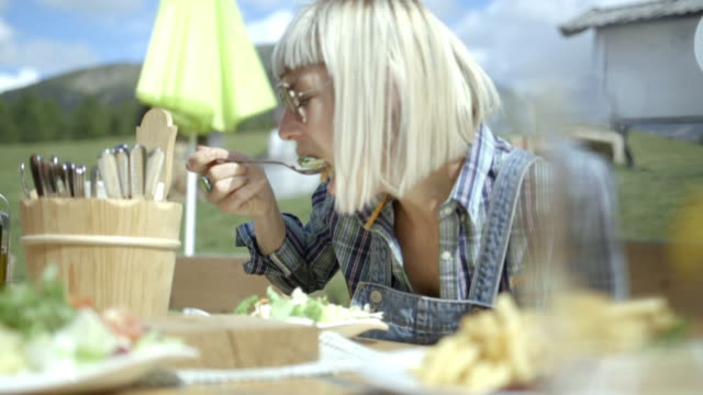 woman eating a meal outdoors - bangs stock videos and b-roll footage