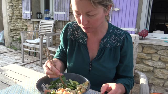 woman eating asian food using chopsticks - meal stock videos & royalty-free footage