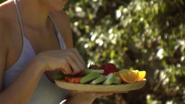 Woman eating celery