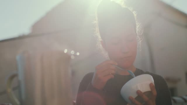 woman eating cereal in sunshine - bowl stock videos and b-roll footage