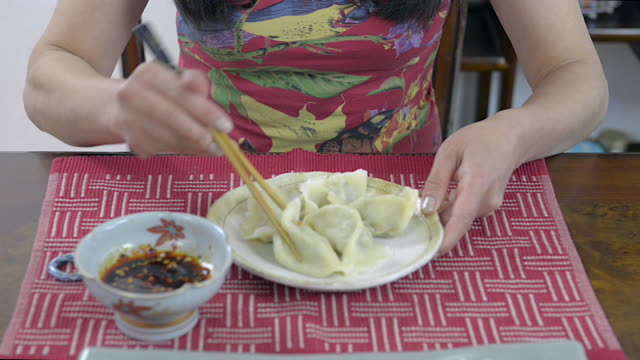 Woman Eating Chinese Dumplings