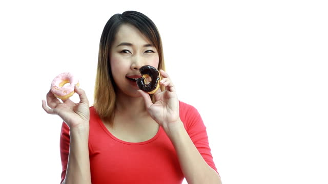 Woman eating donut