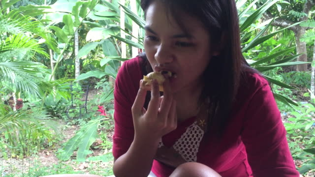 Woman eating durian fruit