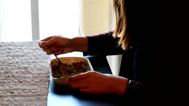 woman eating food at table - microwave stock videos & royalty-free footage
