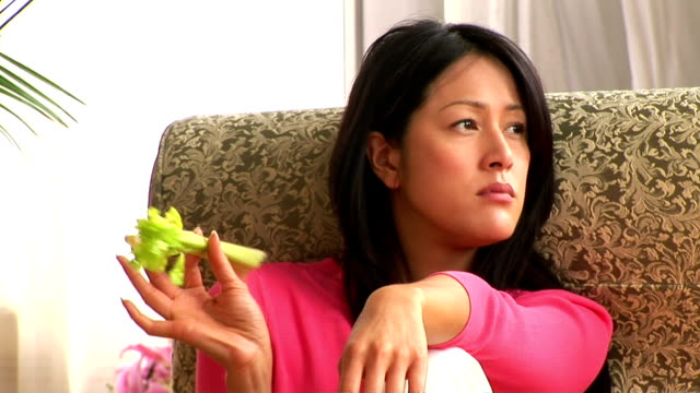 woman eating healthy - celery stock videos & royalty-free footage