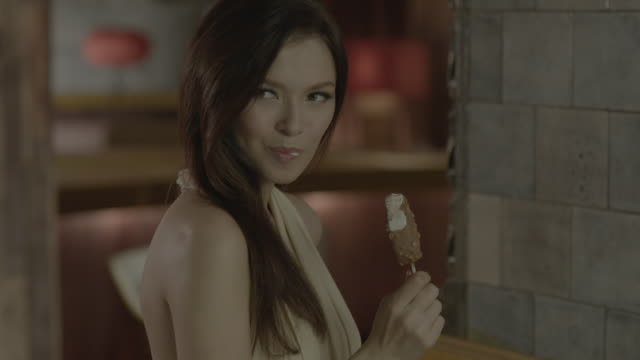 a woman eating ice cream. - temptation stock videos & royalty-free footage