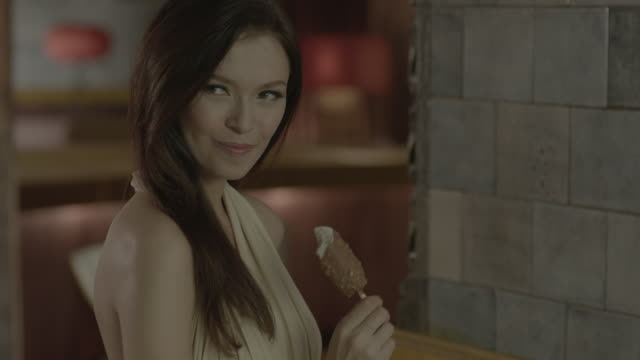 a woman eating ice cream. - pampering stock videos & royalty-free footage