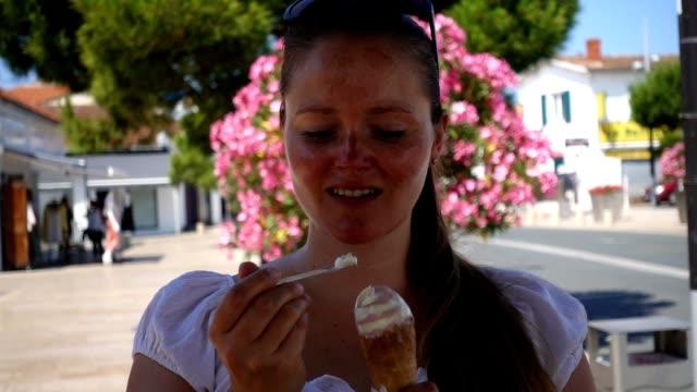 Woman eating icecream.