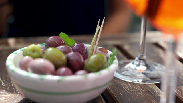 woman eating olives - appetizer stock videos & royalty-free footage
