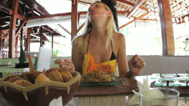 Woman eating pasta; sequence of 2 clips
