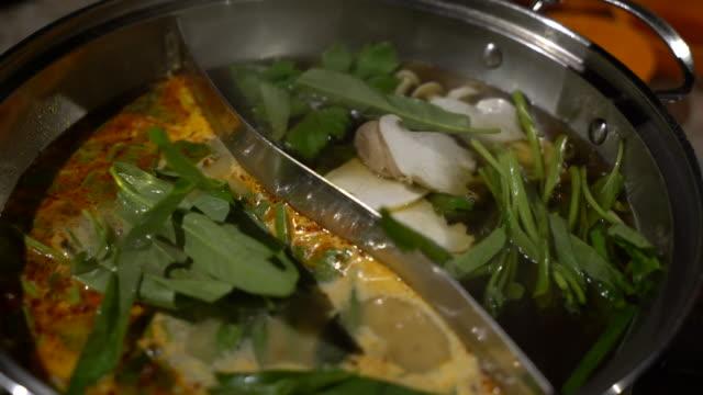 woman eating shabu sukiyaki - sukiyaki stock videos and b-roll footage
