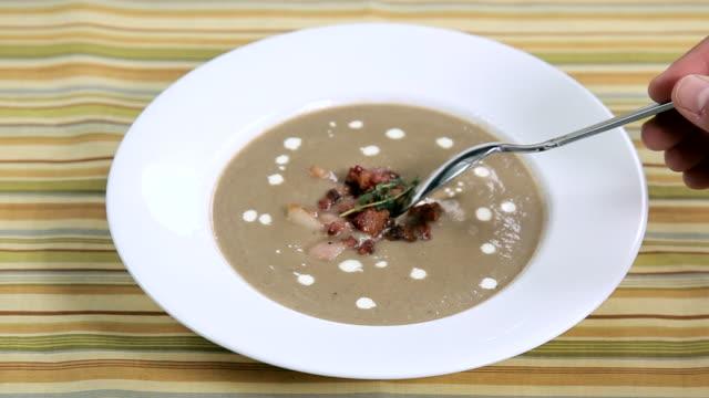POV woman eating soup