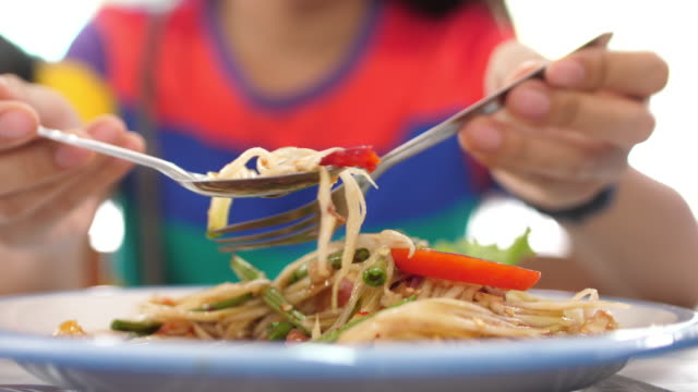 woman eating thai papaya salad in the afternoon, 4k - papaya stock videos & royalty-free footage
