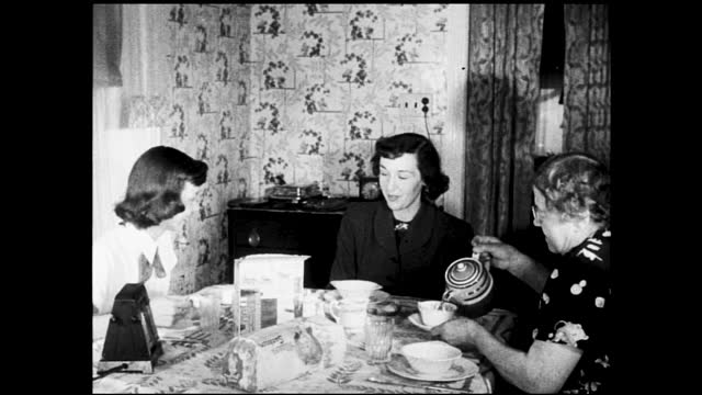 woman eating toast and cereal at table; older woman enters and sits down, grandma pours tea for her - 1940 1949 stock videos & royalty-free footage