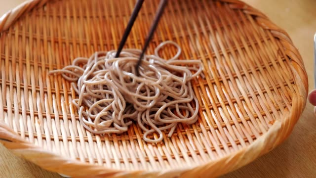 woman eating traditional japanese soba noodles - soba stock videos & royalty-free footage