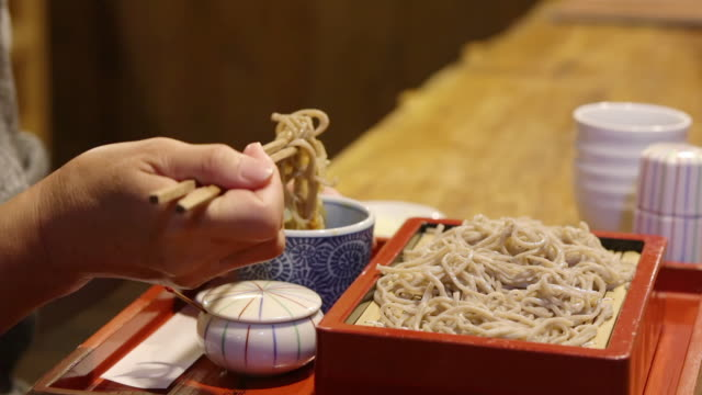 woman eating traditional soba noodles - soba stock videos & royalty-free footage