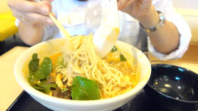 woman eating tsukemen japanese noodles - bamboo shoot stock videos & royalty-free footage