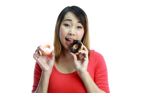 Woman eating two donut.