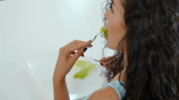 Woman eats salad on the diet