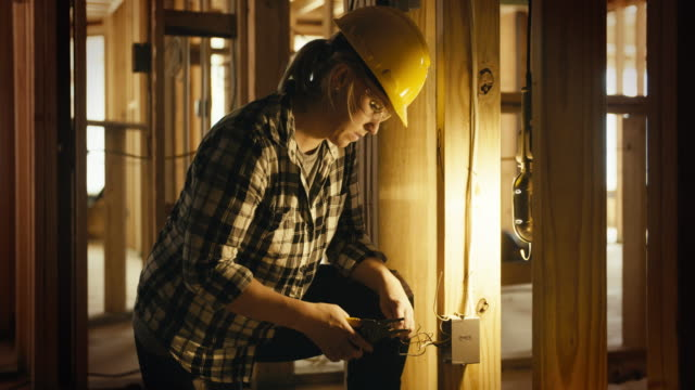 woman electrician - construction worker stock videos and b-roll footage