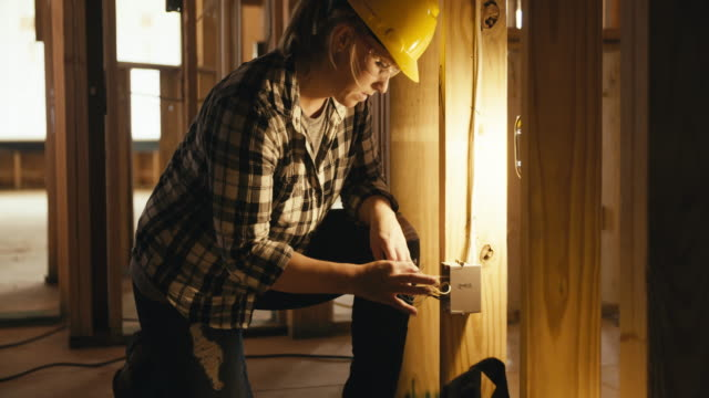 woman electrician - building activity stock videos & royalty-free footage