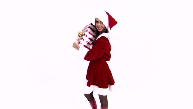 woman embracing gift - mrs claus stock videos and b-roll footage