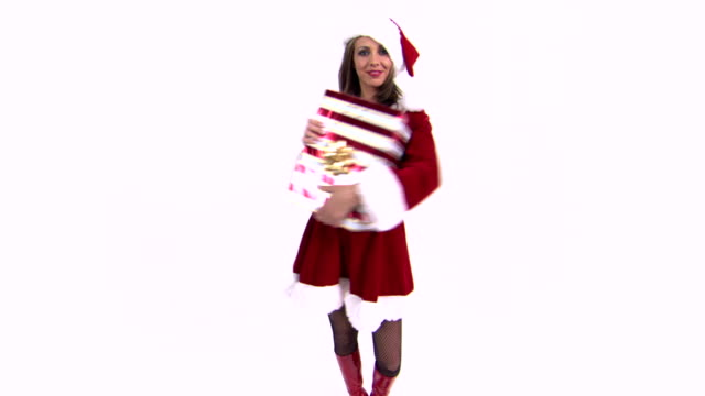 woman embracing gift - weihnachtsfrau stock-videos und b-roll-filmmaterial