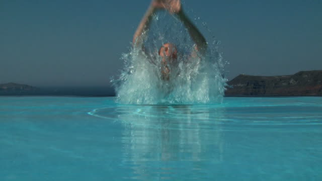 a woman emerging in an infinity pool - see other clips from this shoot 1144 stock videos & royalty-free footage