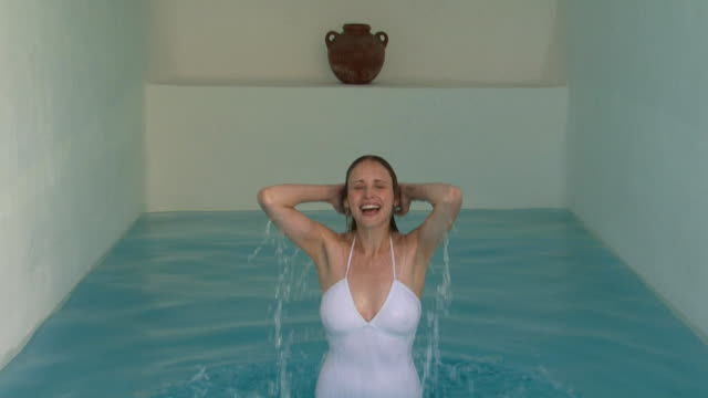 a woman emerging out of an indoor pool - see other clips from this shoot 1144 stock videos & royalty-free footage