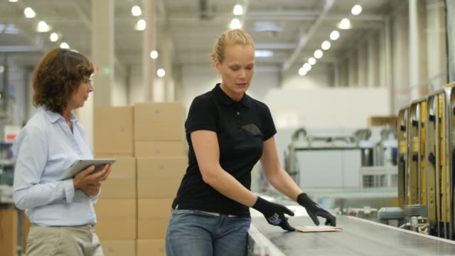 woman employee on the production line talking with her boss - human resources stock videos & royalty-free footage
