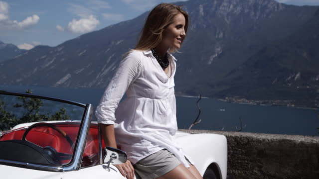woman enjoy lake view - cabriolet bildbanksvideor och videomaterial från bakom kulisserna