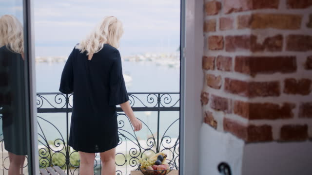 ds woman enjoying a beautiful view of the sea - nightwear stock videos & royalty-free footage