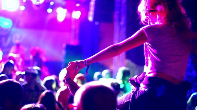 woman enjoying a concert. - shoulder ride woman stock videos & royalty-free footage