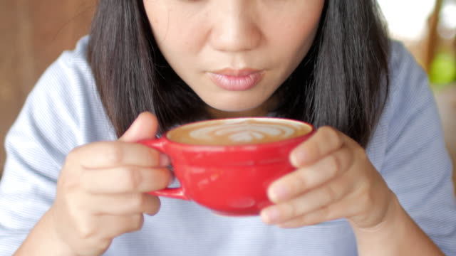 Woman enjoying a cup of coffee in the morning , relaxing time