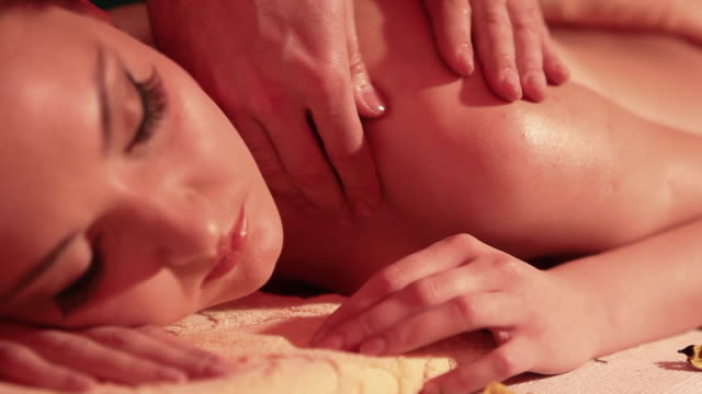 woman enjoying a massage - beauty treatment stock videos and b-roll footage