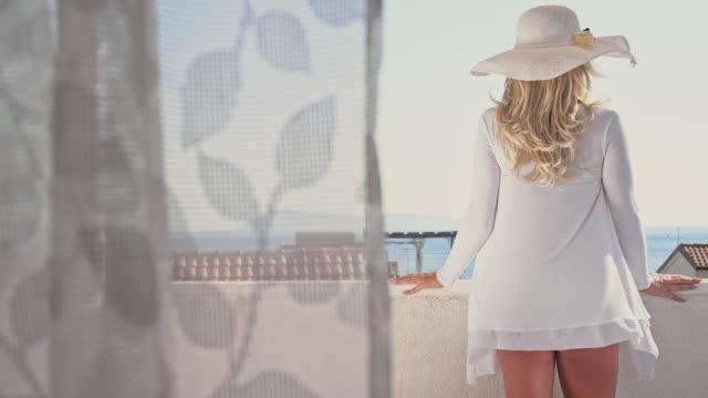 DS Woman enjoying a summer breeze on the balcony