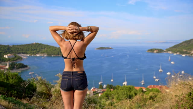 WS Woman enjoying a view over the bay